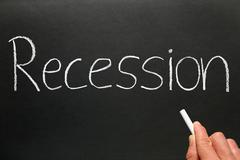 recession written in chalk on a blackboard. - stock photo