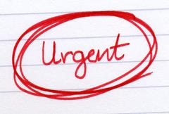 Urgent circled in red ink on white paper. Stock Photos