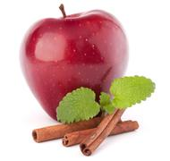 Stock Photo of red apple, cinnamon sticks and mint leaves still life