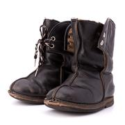 Vintage shabby child's boots Stock Photos