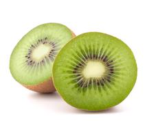 two kiwi fruit sliced halves - stock photo