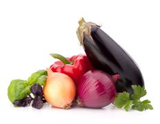 Sweet pepper, onion, tomato, eggplant  and basil leaves  still life Stock Photos