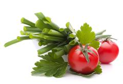 spring onions and cherry tomato in bowl - stock photo
