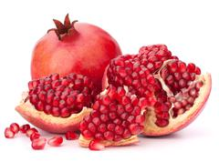 Ripe pomegranate fruit Stock Photos