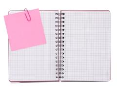 blank checked notebook with notice paper - stock photo