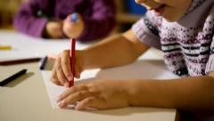 Preschool and fun, happy kids drawing in kindergarten Stock Footage