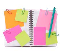 blank checked notebook with notice papers - stock photo