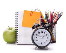 Alarm clock, blank notebook sheet and apple. Stock Photos