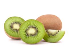 whole kiwi fruit and his segments - stock photo