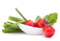 Stock Photo of spring onions and cherry tomato in bowl