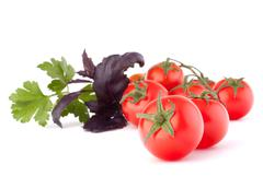 Stock Photo of cherry tomato and basil leaves still life