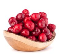 cherry berries in wooden bowl - stock photo