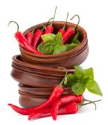 Stock Photo of hot red chili or chilli pepper in wooden bowls stack