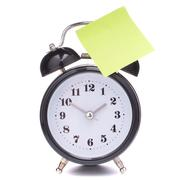 Alarm clock with sticky paper Stock Photos
