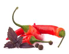 Stock Photo of hot red chili or chilli pepper and basil leaves still life