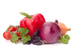 sweet pepper, onion, tomato  and basil leaves  still life - stock photo