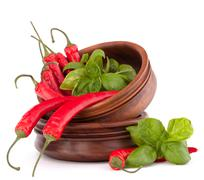 hot red chili or chilli pepper in wooden bowls stack - stock photo