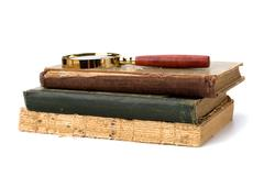 tattered book stack isolated on white background - stock photo