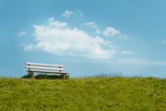 .bench on sky background. tranquil scene.. - stock photo