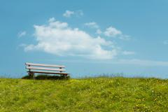 Bench on sky background. tranquil scene. Stock Photos