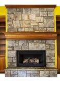 gas insert fireplace with accent walls and shelves - stock photo