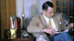 Man READS Magazine READING 1940s (Vintage Film Retro Home Movie) 4409 - stock footage