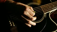 Male hands play on acoustic guitar Stock Footage