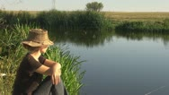 Beautiful woman relaxing rural lake metitative admire lifestyle health water Stock Footage