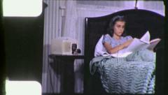 TEEN GIRL READING Studying in Bed 1940s Vintage Film Retro Home Movie 4416 Stock Footage