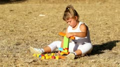 Kid and plastic bricks Stock Footage