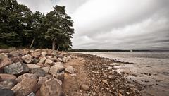desolate rocky beach - stock photo