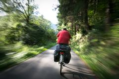 Man riding a bicycle in the wood - stock photo