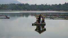 Passenger bamboo raft sails away Stock Footage