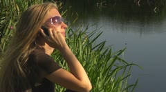 Blonde woman talking at phone family lake businesswoman happy smile optimism  - stock footage