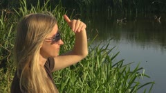 Beautiful woman relaxing nature lake lady glass sitting village rural pond  - stock footage