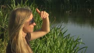 Beautiful woman relaxing nature lake lady glass sitting village rural pond  Stock Footage
