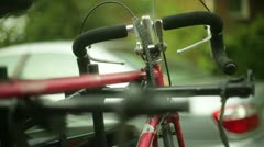 Bike off rack bicycle car Stock Footage