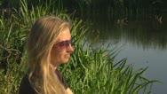 Beautiful woman relaxing wild lake sunglass glamour lifestyle admire blonde Stock Footage