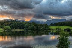 sunset at loughrigg tarn in lake district - stock photo