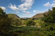 Stock Photo of view over buttermere village to distant hills