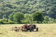 Antique tractor and threshing machine Stock Photos