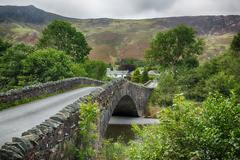 bridge over small river at grange in lake district - stock photo