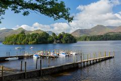 Boats on derwent water in lake district Stock Photos