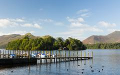 boats on derwent water in lake district - stock photo