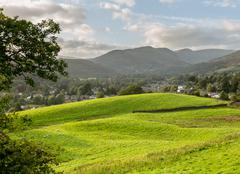 view over fields to ambleside lake district - stock photo