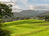 Stock Photo of view over fields to ambleside lake district
