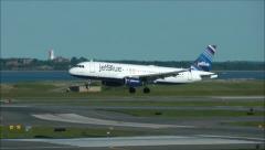 Airplane arrives landing on runway Stock Footage