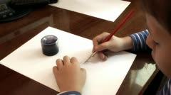 Child writes with a fountain pen Stock Footage