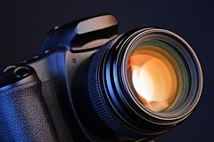 camera with  lens - stock photo