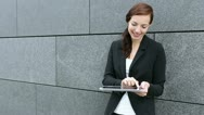 Business woman using tablet computer Stock Footage
